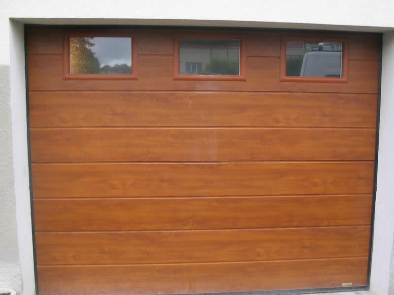 Porte sectionnelle en bois avec hublot Arnaud et Blanc